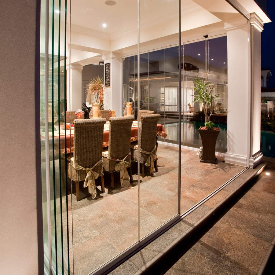 Frameless glass doors for verandah