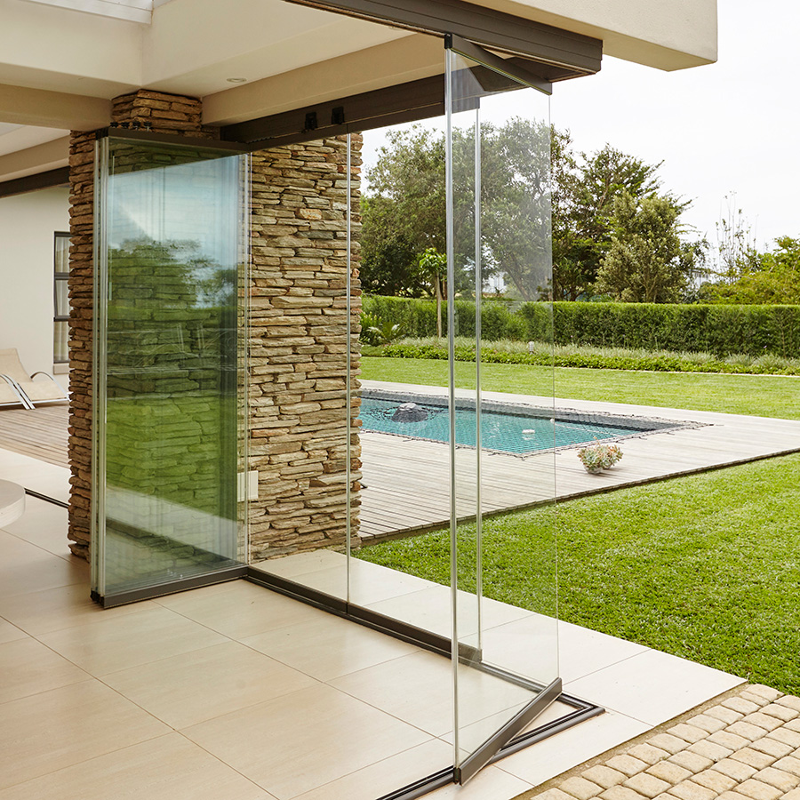 The sunflex sf25 slide turn and stack system is frameless glass and offers clear unobstructed panoramic views through patio doors
